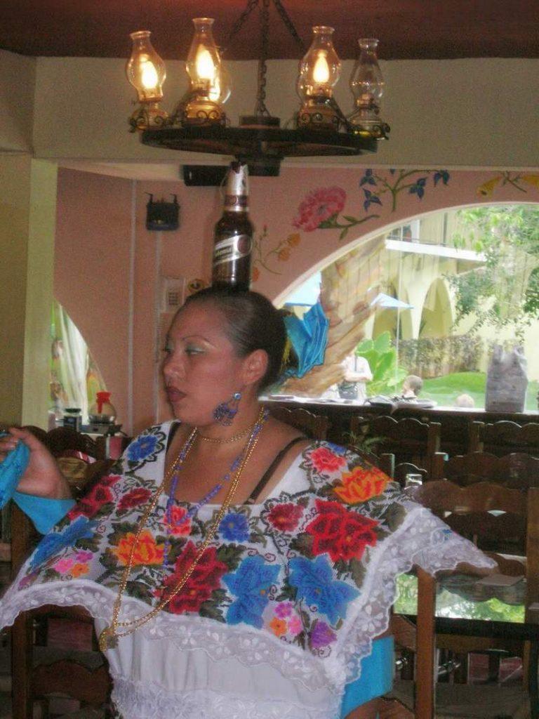 Танц с бутилка на главата